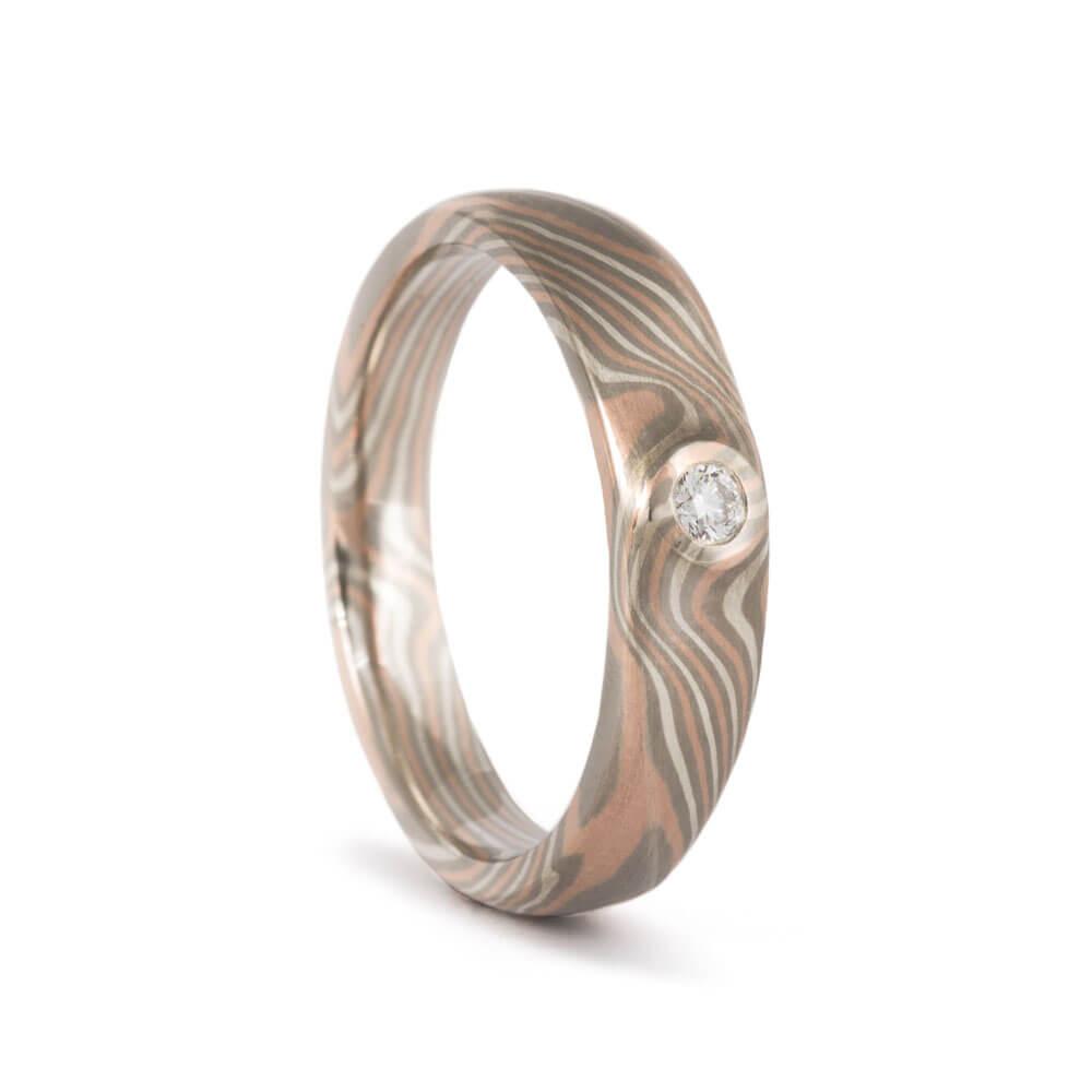 Verlobungsring - aus Mokume Gane mit Diamant im Brillantschliff